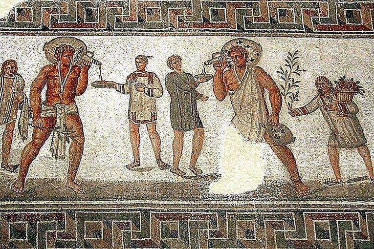Escena con dos esclavos en un mosaico romano en Dougga, Túnez