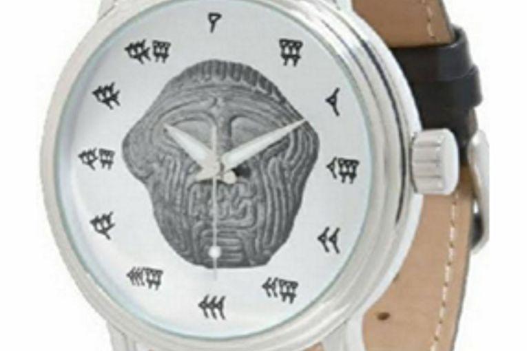 Reloj digital con números cuneiformes